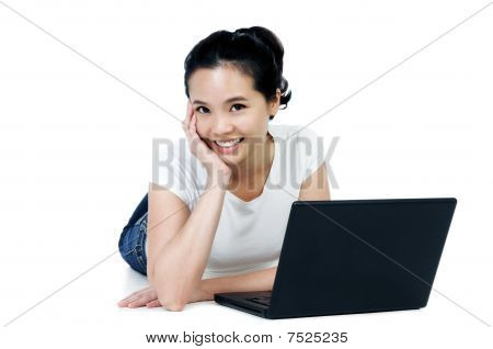 Attractive Woman Lying On Floor With A Laptop