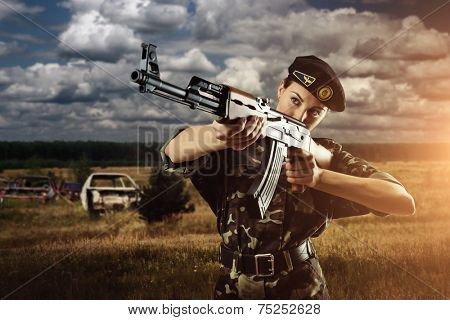 Army soldier woman is on the battle field