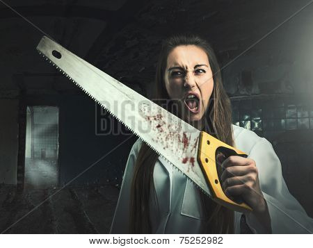 Scary portrait of an angry woman with a saw