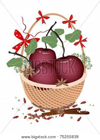 A Brown Basket of Christmas Apples and Spices