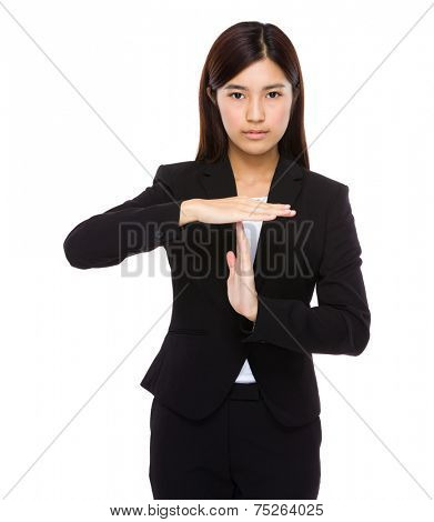 Serious businesswoman with hand show with pause gesture