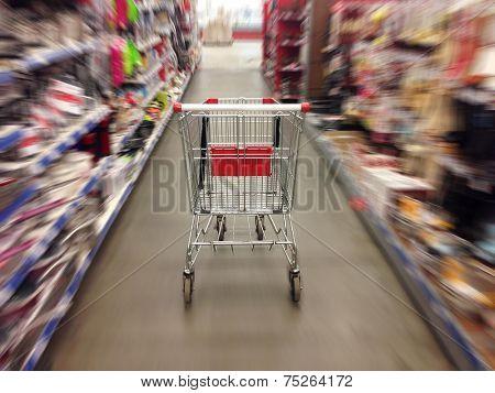 Shopping in supermarket. Shoping cart