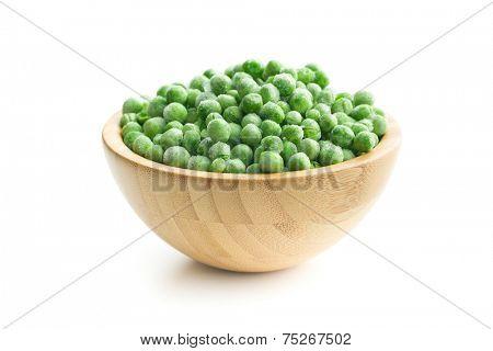 frozen peas in wooden bowl