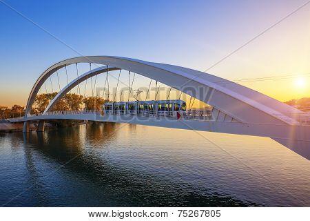 Tramway On The Bridge At Sunset