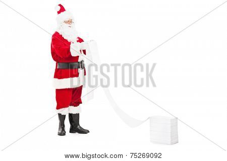 Santa Claus reading a list of wishes isolated on white background