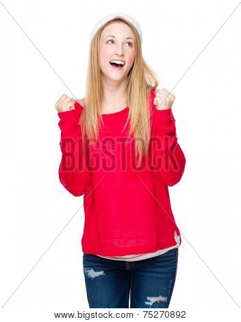 Woman with santa hat feeling excite