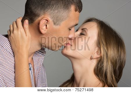 Enamoured young man and woman kissing