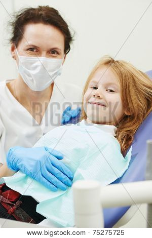 dentist orthodontist female doctor wich child client at working place