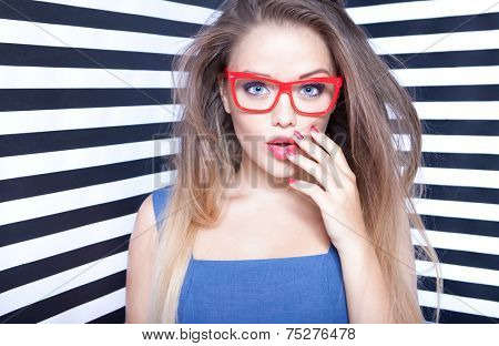 Attractive surprised young woman wearing glasses on stripy background, beauty and fashion concept