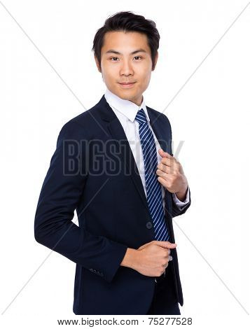 Businessman hold his suit collar