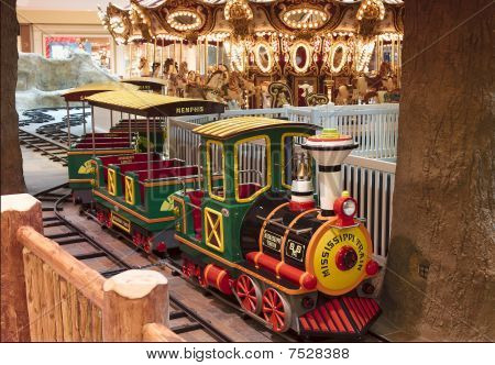 Child Train Ride in Amusement Park