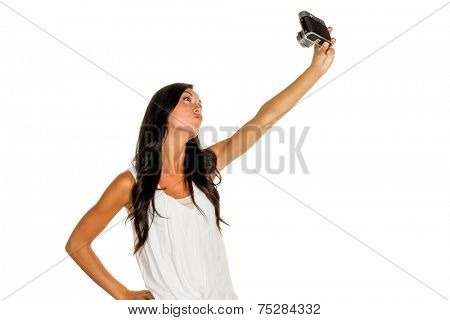a young woman has fun while they themselves photographed with an old camera. selfie