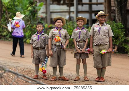 UTTARADIT, THAILAND, JULY 11, 2013: Thai boyscouts are posing early morning in a countryside district of Uttaradit, Thailand