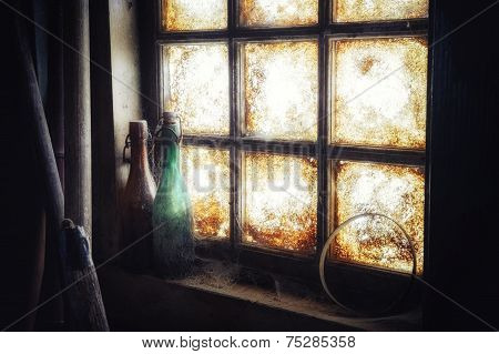 Old Dirty Window With Dusty Bottles