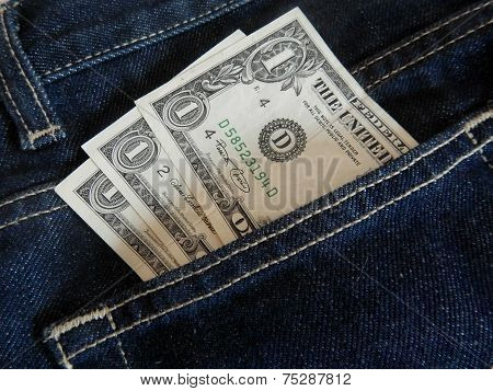 Dollar banknotes in jeans pocket