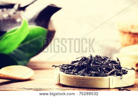 Closeup Of Black Tea And Teapot