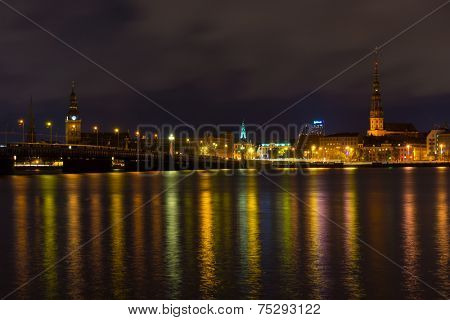 Night landscape of Daugava river, old town at night in Riga, Latvia
