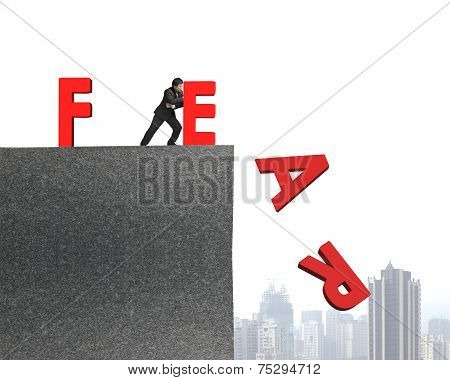 Businessman Pushing Red Fear Word Down