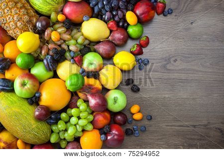 Mix of Fresh Fruits  on dark wooden table with copy space