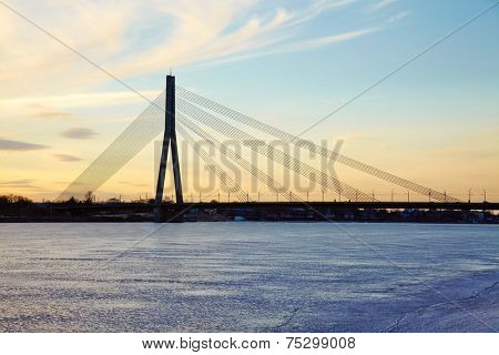Bridge over the frozen Daugava river in Riga