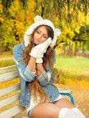 image of debonair  - Autumn outdoor portrait of a cute girl in a bear hat - JPG