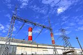 foto of chp  - Industrial plant with high chimneys and power lines - JPG