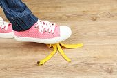 image of slip hazard  - Shoe to slip on banana peel and have an accident - JPG
