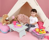 foto of teepee tent  - Toddler child kid engaged in pretend play with food stuffed toys and teepee tent - JPG
