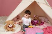 image of teepee  - Toddler child kid engaged in pretend play with food stuffed toys and teepee tent - JPG