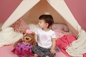 foto of toddlers tiaras  - Toddler child kid engaged in pretend play with princess crown and teepee tent - JPG
