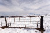picture of plateau  - Gate fence in high plateau mountain terrain in winter snow scenic landscape - JPG