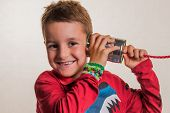 stock photo of tin can phone  - child listens in a tin can phone - JPG