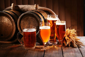 picture of beaker  - Beer barrel with beer glasses on table on wooden background - JPG