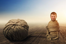 pic of adversity humor  - Man in captivity of threads - JPG