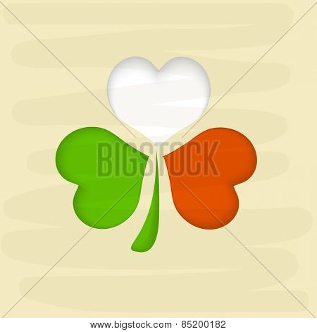 Happy St. Patrick's Day celebration with shamrock leaf in Irish Flag colors.