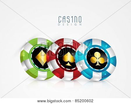 Shiny colorful casino chips on white background.
