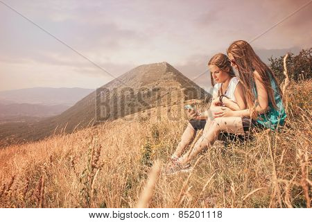 Girls in nature with smart phone