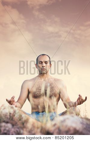 Man in nature meditate in lotus position