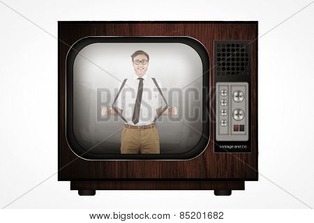 Geeky businessman pulling his suspenders against retro tv