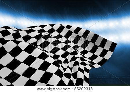 Checkered flag against football pitch under blue lights