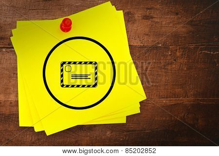 Envelope graphic against sticky note with red pushpin