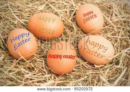 happy easter against five eggs nestled in straw
