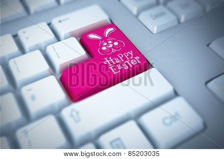 easter bunny with greeting against pink enter key on keyboard