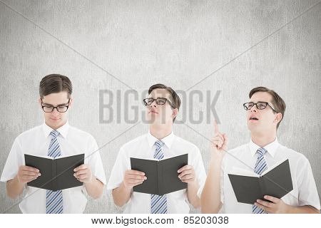 Nerd reading book against white and grey background