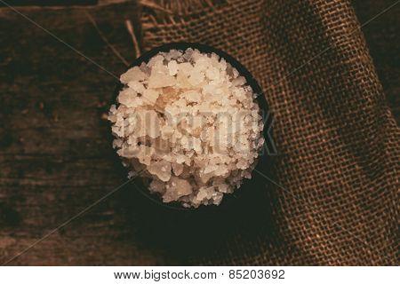 Sea salt on the wooden table