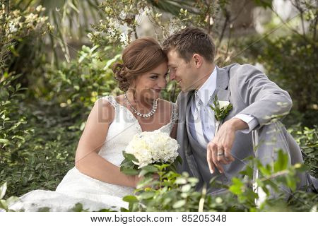 young newly married couple together in a garden