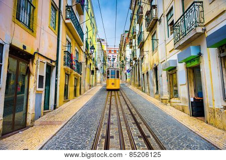 Lisbon, Portugal old town streets and tram.