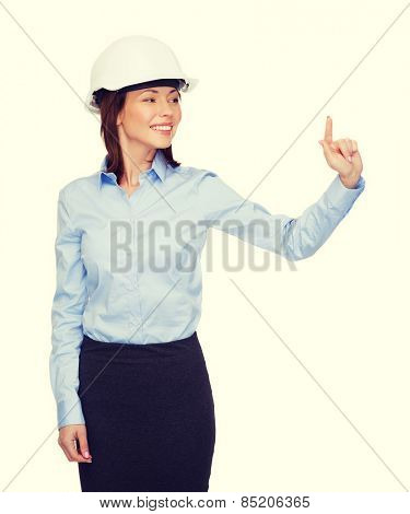 building, developing, consrtuction and architecture concept - young smiling businesswoman in white helmet working with virtual screen