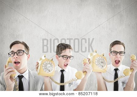 Nerdy businessman with phone against white and grey background