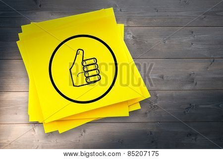 Thumbs up graphic against sticky note